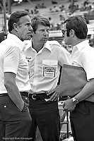 HAMPTON, GA - APRIL 22:  Team McLaren's Bill Smith (left) and Tyler Alexander (center) speak with Dan Luginbuhl  (right), Vice President Communications for Penske Corporation, in the pit lane before practice for the Gould Twin Dixie 125 event on April 22, 1979, at Atlanta International Raceway near Hampton, Georgia.