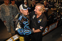 Nov 4, 2007; Pomona, CA, USA; NHRA top fuel dragster driver Tony Schumacher celebrates with his father Don Schumacher after winning the race and the 2007 top fuel championship during the Auto Club Finals at Auto Club Raceway at Pomona. Mandatory Credit: Mark J. Rebilas-US PRESSWIRE