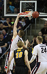 Gonzaga's Domamtas Sabonis (11) goes up for two points against Iowa's Gabriel Olaseni (0)  during the 2015 NCAA Division I Men's Basketball Championship's March 22, 2015 at the Key Arena in Seattle, Washington. #2 Gonzaga beat #7 Iowa 87-68 to advance to the Sweet 16.   ©2015. Jim Bryant Photo. ALL RIGHTS RESERVED.