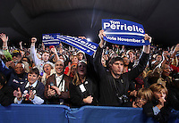 Oct 29, 2010. Audience members cheer for Preisdent Barack Obama during the campaign rally for Virginia 5th District Representative Congressman Tom Perriello Friday at the Charlottesville Pavilion in downtown Charlottesville, Va. Photo/Andrew Shurtleff