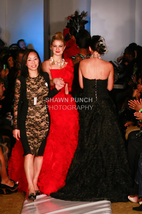 Fashion designer Vanni Wang, walks runway with models at the close of her Lucio Vanni Couture Fall 2012 collection fashion show, during Plitzs Fashion Week New York Fall 2012.