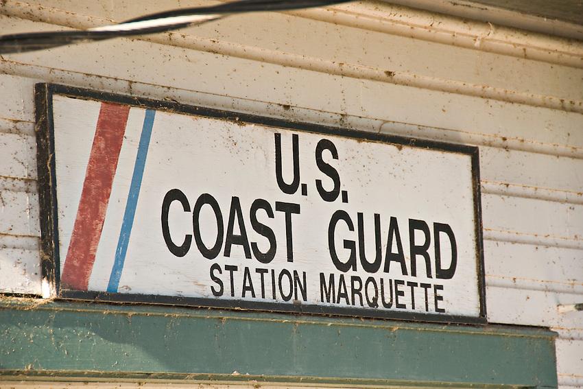 United States Coast Guard station sign in Marquette Michigan.