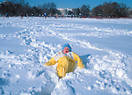 Baby sitting in snow on the Ellipse behind the White House in Washington, DC in February 1983.
