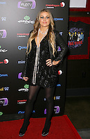 CARMEN ELECTRA .At SWAGG VIP Kid Rock Concert at the Joint inside the Hard Rock Hotel and Casino, Las Vegas, Nevada, USA,.7th January 2010..full length black leather jacket dress tights necklace platform shoes pearls beads hand on hip .CAP/ADM/MJT.© MJT/AdMedia/Capital Pictures.