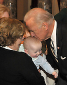 Washington, DC - January 27, 2009 --United States Vice Joseph Biden kisses Henry Gillibrand, youngest son of  United States Senator Kirsten Gillibrand (Democrat of New York) in the Old Senate Chamber of the United States Capitol in Washington, D.C. on Tuesday, January 27, 2009..Credit: Ron Sachs / CNP.(RESTRICTION: NO New York or New Jersey Newspapers or newspapers within a 75 mile radius of New York City)
