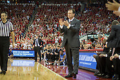 Duke Head Coach Mike Krzyzewski and NC State Head Coach Mark Gottfried react differently to a foul call during the second half of Saturday's ACC match-up at PNC Arena, Raleigh, NC, Jan. 12, 2013.