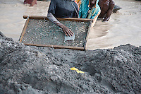 19 January 2008, Kolwezi, DRC. Diggers panning for copper tailings downstream from the large-scale industrialised mines in Kolwezi. The tailings are of a particularly high quality, allowing the diggers to earn a good living. One was a university student working just long enough to earn enough money to return to university.