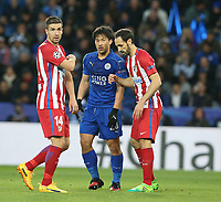 Leicester City's Shinji Okazaki closely marked by Atletico Madrid's Juanfran (right) and Gabi (left)<br /> <br /> Photographer Stephen White/CameraSport<br /> <br /> UEFA Champions League Quarter Final Second Leg - Leicester City v Atletico Madrid - Tuesday 18th April 2017 - King Power Stadium - Leicester <br />  <br /> World Copyright &copy; 2017 CameraSport. All rights reserved. 43 Linden Ave. Countesthorpe. Leicester. England. LE8 5PG - Tel: +44 (0) 116 277 4147 - admin@camerasport.com - www.camerasport.com