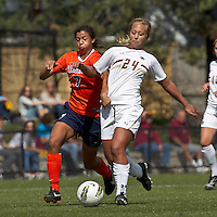 University of Virginia forward Gloria Douglas (7) and Boston College forward/midfielder Rachel Davitt (24) battle for the ball. Boston College defeated University of Virginia, 2-0, at the Newton Soccer Field, on September 18, 2011.