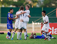 Matthew Dunn (5) of the United States jumps into the arms of teammate Zachary Carroll (17) while celebrating after the quarterfinals of the CONCACAF Men's Under 17 Championship at Catherine Hall Stadium in Montego Bay, Jamaica. The USA defeated El Salvador, 3-2, in overtime.
