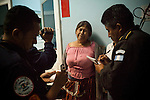 At Roosevelt Hospital a woman is questioned by firefighters who report back to newspapers on the death of her 16-year-old son who was shot and killed by a gunman while walking back home from visiting his girlfriend, in Guatemala City, Guatemala, on Saturday, Nov. 5, 2011. Gun smuggling is prevalent because of corruption and drug cartels provide guns to smaller drug gangs.