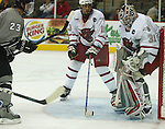 10/22/04 Omaha, NE University of Nebraska at Omaha's Bobby Henderson and goalie Chris Holt defend against  Western Michigan University 's Mike Erickson shot at the Qwest Center Omaha...(Chris Machian/Prairie Pixel Group)