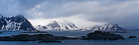 Moutnains peaks rise from sea, viewed from Stamsund, Vestvågøy, Lofoten islands, Norway