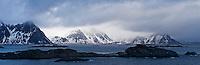 Moutnains peaks rise from sea, viewed from Stamsund, Vestvågøy, Lofoten islands, Norway