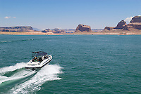 Small wakeboard boat driving on Lake Powell
