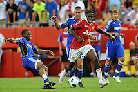 Danny Welbeck, Korede Alyegbusi (blue)..Kansas City Wizards defeated Manchester United 2-1 in an international friendly at Arrowhead Stadium, Kansas City, Missouri.