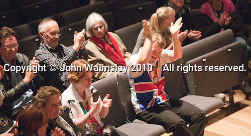 "Two of the Special Olympics athletes applauding.  Special Olympics Surrey put on a show,   ""Beyond the Stars"", at the Rose Theatre, Kingston upon Thames to raise money for the  SOGB team.  The Special Olympics are for athletes with learning disabilities."