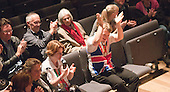 """Two of the Special Olympics athletes applauding.  Special Olympics Surrey put on a show,   """"Beyond the Stars"""", at the Rose Theatre, Kingston upon Thames to raise money for the  SOGB team.  The Special Olympics are for athletes with learning disabilities."""