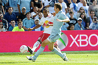 Red Bull midfielder Dane Ricahrds gets a cross in despite the efforts of Sporting KC defender Matt Besler...Sporting Kansas City defeated New York Red Bulls 2-0 at LIVESTRONG Sporting Park, Kansas City, Kansas.