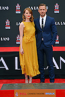 Actors Emma Stone &amp; Ryan Gosling at the TCL Chinese Theatre, Hollywood, where the stars of La La Land had their hand &amp; footprints set in cement. <br /> December 7, 2016<br /> Picture: Paul Smith/Featureflash/SilverHub 0208 004 5359/ 07711 972644 Editors@silverhubmedia.com