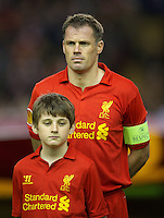 LIVERPOOL, ENGLAND - Thursday, October 4, 2012: Liverpool's captain Jamie Carragher lines-up before the UEFA Europa League Group A match against Udinese Calcio at Anfield. (Pic by David Rawcliffe/Propaganda)