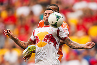 Jonny Steele (22) of the New York Red Bulls battles Ricardo Clark (13) of the Houston Dynamo for the ball during a Major League Soccer (MLS) match at Red Bull Arena in Harrison, NJ, on June 30, 2013.