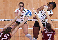 Kyna Washington hits the ball past Arkansas Amy Allison and Christina Lawrence as LSU defeats the Razorbacks 3-0 Wednesday November 8, 2006 n the Pete Maravich Assembly Center.