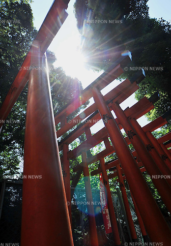 July 9th, 2011, Tokyo, Japan - The scorching summer sun bakes gates of a Shinto shrine at Tokyos Ueno Park on sweltering Saturday afternoon, July 9, 2011. The mercury hit 32 degrees Celsius as the rainy season for the Kanto region,inclding the Tokyo metropolitan area, officially ended on Saturday. The Meteorological Agency predicts temperatures in the Kanto area will be higher than average in the three-month period from July, and severe late-summer heat will persist to September. The agency called for precautions for possible heatstroke if people refrain too much from using air conditioning amid the nationwide power-saving drive. (Photo by Natsuki Sakai/Aflo) [3615] -mis-