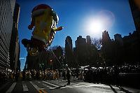 USA, New York, Nov 28, 2013. The Spongebob Squarepants balloon floats while people take part in the 87th Macy's Thanksgiving Day Parade in New York City. Photo by VIEWpress/Eduardo Munoz Alvarez