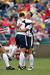 Lori Chalupny (l) and Kate Markgraf (r) celebrate after Chalupny's 12th minute goal had given the United States a 1-0 lead on Sunday June 26th, 2005, during an international friendly soccer match at Virginia Beach Sportsplex in Virginia Beach, Virginia. The United States won the game 2-0.