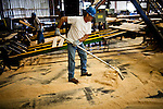 Jesus Perez sweeps up sawdust at the Sierra Pacific lumber mill in Chinese Camp, Calif., July 25, 2012..CREDIT: Max Whittaker/Prime for The Wall Street Journal.TIMBER
