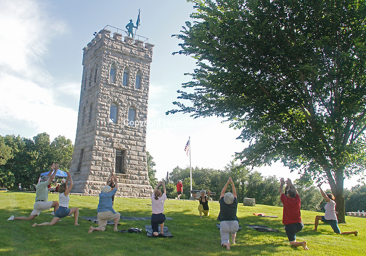 Winsted, CT-072614MK11 Yoda instructor Fran Herman leads a yoga class during The Soldiers Monument Commission picnic at the memorial park in Winsted on Saturday afternoon.  The event was held to to raise money and awareness of the monument, which is dedicated in the memory of local Civil War soldiers. The commission is struggling to recover the $130,000 former Finance Director Henry L. Centrella Jr. stole from its renovation account.  Jack Bourque, commission member, said that over fifty visitors came to enjoy food, activities and raffle items that thirty-seven local businesses had donated. Michael Kabelka / Republican-American.