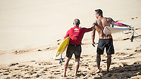 Waimea Bay, North Shore, Oahu, Hawaii (Wednesday, February 10 2016): Tom Carroll (AUS)  and Sunny Garcia (HAW). - The Quiksilver In Memory of Eddie Aikau was given the Green light 'Go' signal two days ago with a forecasted big swell due to hit on Wednesday morning. Everything was put in place for the event to kick off with some contestants flying into Hawaii from Chile, France, Australia and the US mainland. Unfortunalty the predicted swell failed to arrive as predicted as the storm front moved North of the islands forcing the postponement . <br /> Photo: joliphotos.com