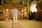 Mr. Juriga prays in the Orthodox church in Vilemov, Czech Republic..Mr. Juriga was an outspoken anti-communist in his youth (he learned English from textbooks to escape communism) Mr. Jurigas faith led him to join the Orthodox church and to study theology at a time when anti-communists were prohibited from studying. His vision to create a renewable energy future for the church and community of Vilemov was realised through the support of the church. Mr. Juriga is currently the director of the Orthodox Academy, an institute that helps educate school kids about clean energy in Czech Republic. The Academy runs solar, wind and hydro installations and is supported by the revenue generated from the wind energy...He strongly believes that community involvement and small-scale energy production is essential to the development of a post carbon world. Unfortunately, the system in the Czech Republic and Slovakia is heavily tilted in favour of large energy producers. The process is buried in bureaucracy and controlled by industry heavy weights, meaning it is tough for independent producers or communities to raise the funds and/or complete the process.