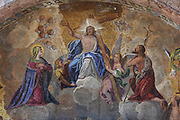 Christ in Glory from the Last Judgement mosaic, with Christ in heaven holding the cross, with angels, the Virgin and St John the Baptist, 1836, by Lattanzio Querena, over the main portal of Western facade of St Mark's Basilica, or Basilica San Marco, Venice. This 19th century copy replaces the original mosaic which was destroyed by fire. The basilica was consecrated 1084-1117 and was originally the chapel of the Doge, becoming the city's cathedral in 1807. The city of Venice is an archipelago of 117 small islands separated by canals and linked by bridges, in the Venetian Lagoon. The historical centre of Venice is listed as a UNESCO World Heritage Site. Picture by Manuel Cohen