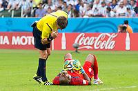 Goalkeeper Vincent Enyeama of Nigeria looks in pain