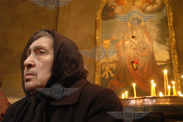 An elderly Armenian woman attends a mass held for the 18th Century Armenian poet Sayat Nova at the Church of St Giorgis (Saint George) on May 28. This is the day that Armenians gather together to remember the poet who used to recite his verses at the church.