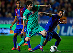 Levante's Cabral (R) vies for the ball with FC Barcelona's Lionel Messi (R) during the Spanish league football match Levante UD vs FC Barcelona on April 14, 2012 at the Ciudad de Valencia Stadium in Valencia. (Photo by Xaume Olleros/Action Plus)