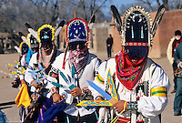 A line of mysterious, veiled Matachine dancers performs on Christmas Morining at San Juan Pueblo, also known as Okay Owingeh, near the town of Espanola in Northern New Mexico