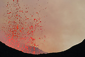 Nyamuragira Volcano, Kimanura Eruption 2011-2012 showing incandescent basaltic lava bombs being expelled from the crater, Democratic Republic of the Congo.