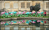 BNPS.co.uk (01202 558833)<br /> Pic: Longleat/BNPS<br /> <br /> Silk crocus flowers and a huge new bronze lion are stored in front of Longleat House.<br /> <br /> A team of highly skilled artisans from Zigong in China's Sichuan province are hard at work producing thousands of illuminated lanterns for the Longleat Festival of light this autumn.<br /> <br /> The annual event is the largest ever staged in the UK, and features over 30,000 lightbulbs, 20km of silk and 4km of LED's, along with a 20 metre tall cake and life size porcelain elephants.