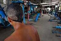 A young Cuban man stands in a bodybuilding gym in Alamar, a public housing complex in the Eastern Havana, Cuba, 9 February 2011.