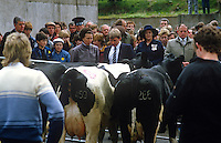 Princess Anne at Enniskillen Agricultural College is briefed about dairy cattle by Clarke Black, president, Young Farmers' Clubs of N Ireland. The event was one of several during a May 1985 Royal Visit to N Ireland. 19850503a..Copyright Image from Victor Patterson, 54 Dorchester Park, Belfast, UK, BT9 6RJ..Tel: +44 28 9066 1296.Mob: +44 7802 353836.Voicemail +44 20 8816 7153.Skype: victorpattersonbelfast.Email: victorpatterson@me.com.Email: victorpatterson@ireland.com (back-up)..IMPORTANT: If you wish to use this image or any other of my images please go to www.victorpatterson.com and click on the Terms & Conditions. Then contact me by email or phone with the reference number(s) of the image(s) concerned.