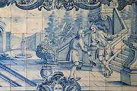 The gardener and his master, from the fables of La Fontaine, traditional blue and white azulejos tile scene, 18th century, in the cloister of the Monastery of Sao Vicente de Fora, an Augustinian order monastery and church built in the 17th century in Mannerist style, Lisbon, Portugal. The monastery also contains the royal pantheon of the Braganza monarchs of Portugal. Picture by Manuel Cohen