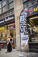 Shoppers outside the Buffalo Exchange second-hand clothing store in the Chelsea neighborhood of New York on Friday, August 1, 2014. (© Richard B. Levine)
