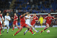 Ashley Williams of Wales and Riku Riski of Finland battle against each other to get to the ball during the Wales v Finland Vauxhall International friendly football match at the Cardiff City stadium, Cardiff, Wales. Photographer - Jeff Thomas Photography. Mob 07837 386244. All use of pictures are chargeable.