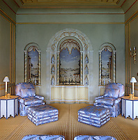 Antique style wall paintings of an old view of the Bosphorus decorate the alcoves of this living room
