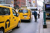 A passenger exits a cab in New York on Firday, May 1, 2015.   (© Richard B. Levine)