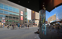 Part of Alexanderplatz, with cinema and shops, Berlin, Germany. Berolinahaus reflected in the glass on the the right. Picture by Manuel Cohen