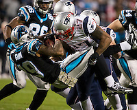 The Carolina Panthers play the New England Patriots at Bank of America Stadium in Charlotte North Carolina on Monday Night Football.  The Panthers defeated the Patriots 24-20.  Carolina Panthers wide receiver Ted Ginn (19), New England Patriots strong safety Tavon Wilson (27)